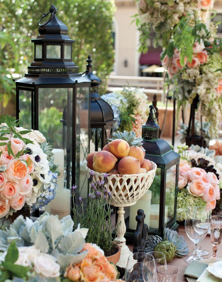 Peaches, peonies and lanterns wedding table decor