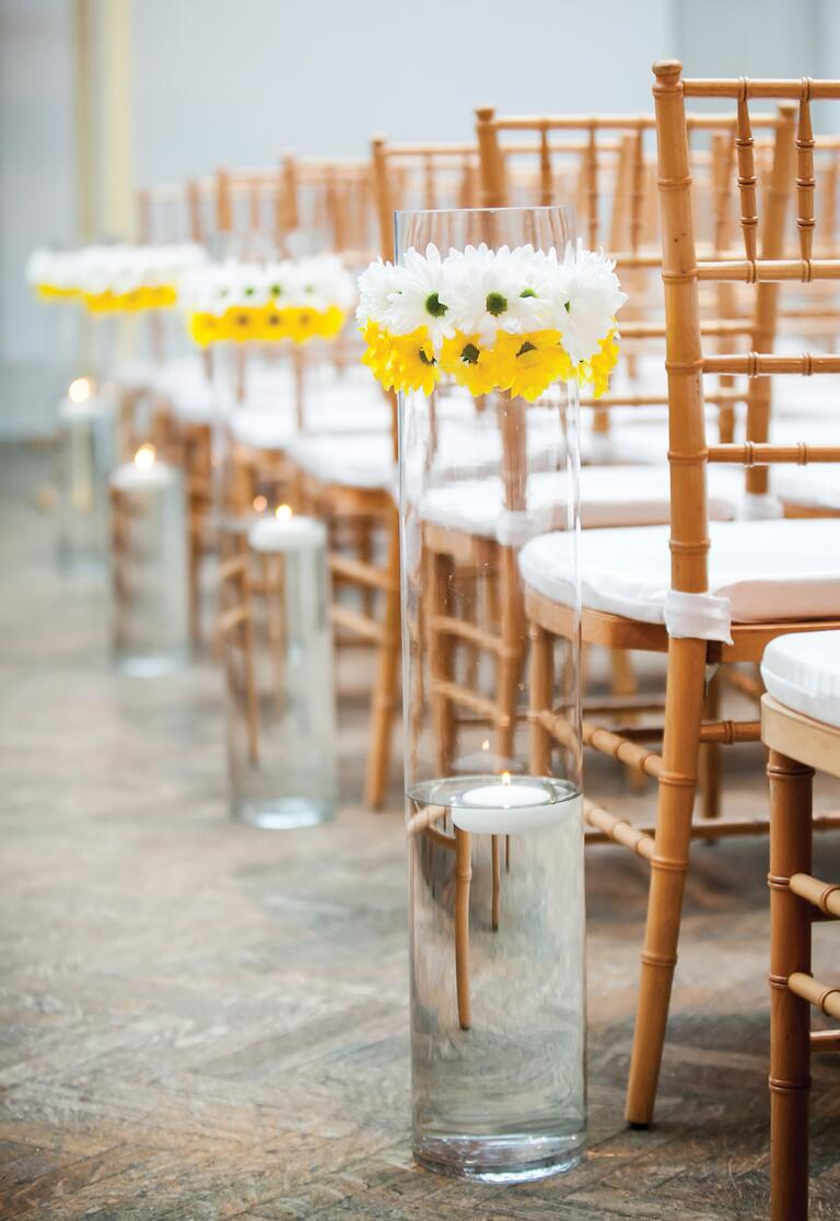 White and yellow daisy aisle decor