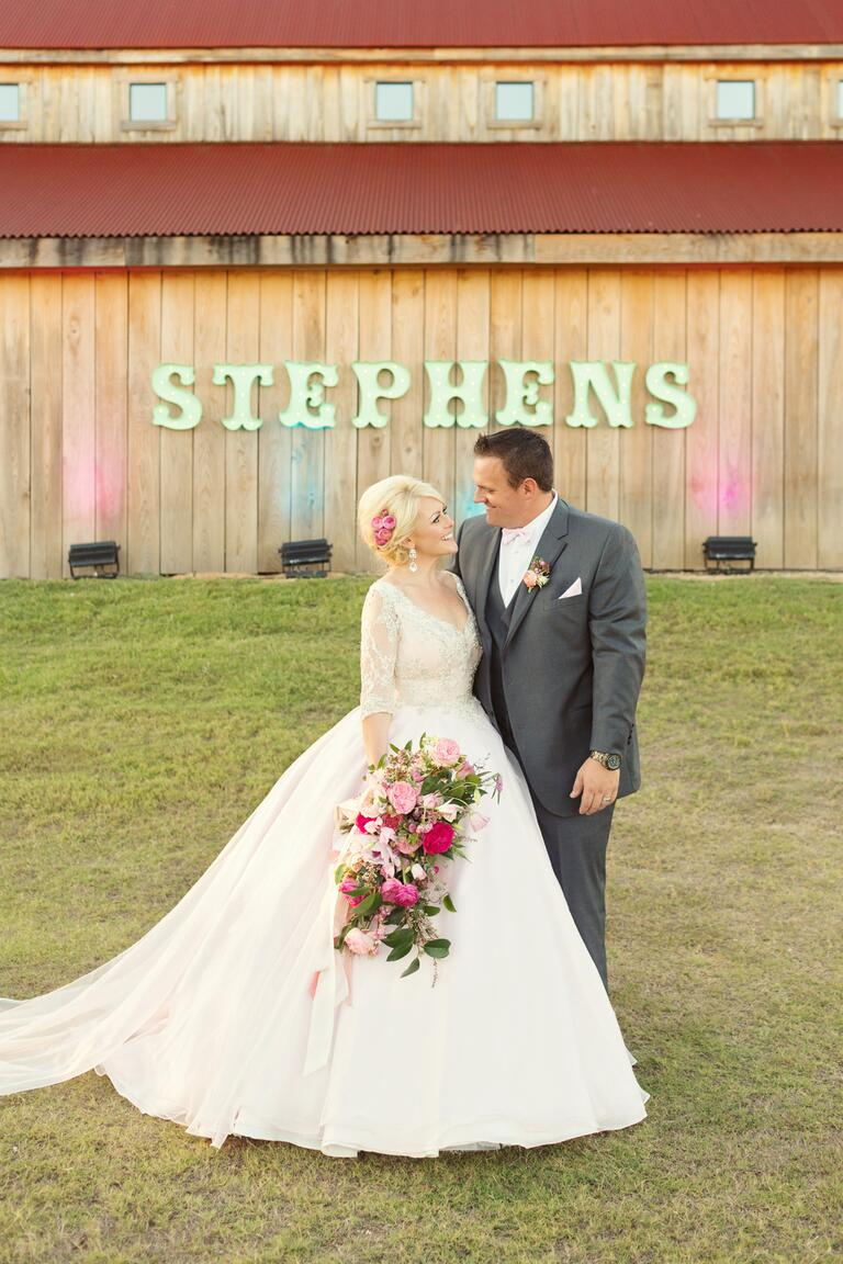 Pink uplighting against rustic barn background