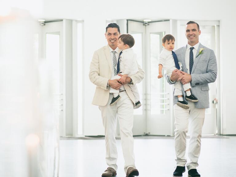 Dad Grooms Carrying Sons -- same-sex wedding