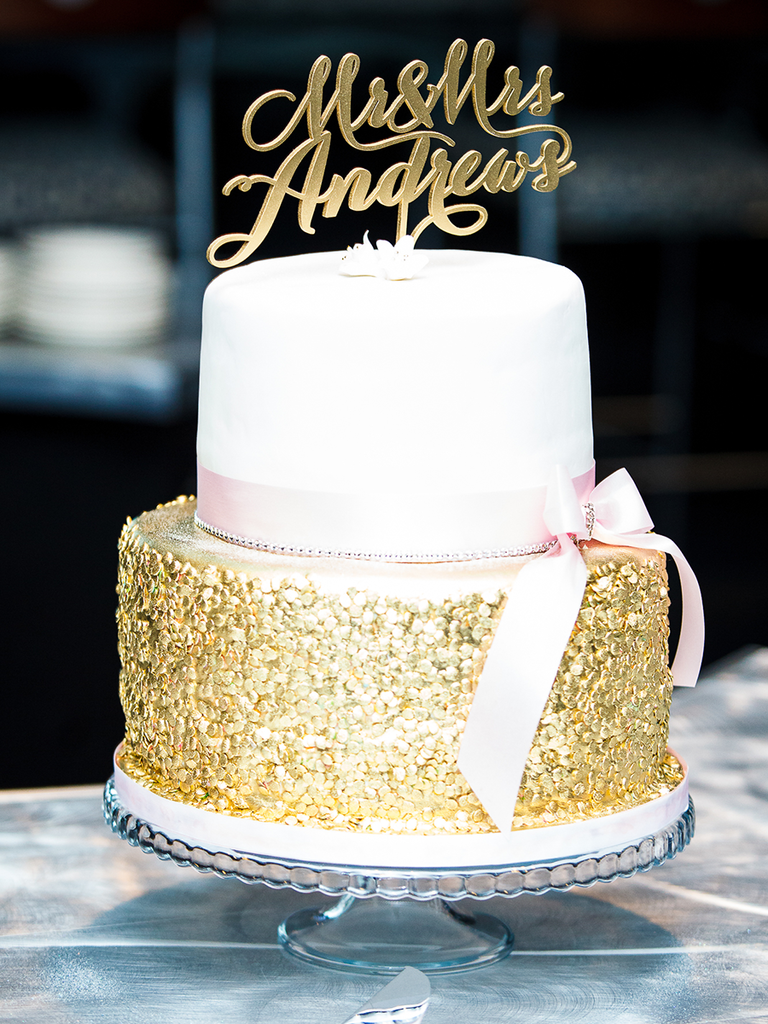 Simple two-tiered wedding cake with metallic gold detailing