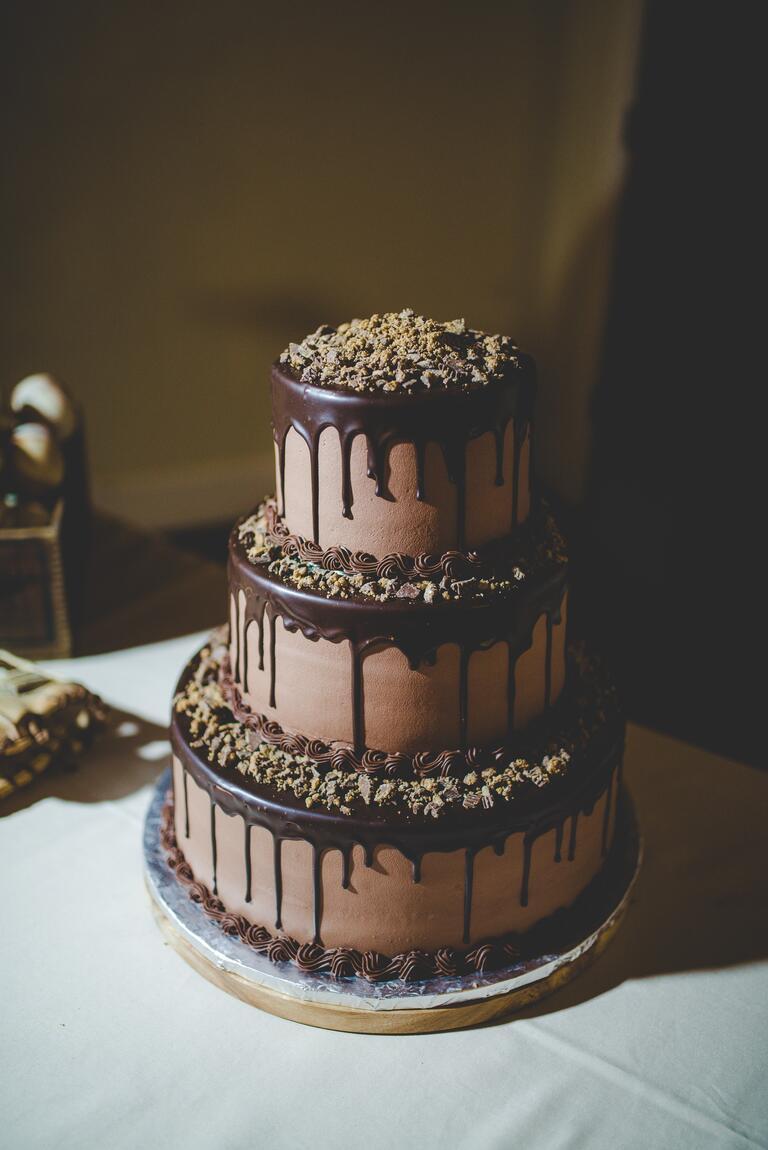 Three-tier chocolate cake with dripping ganache