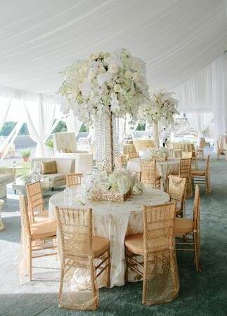 White, Tall Centerpieces // Photo: Allan Zepeda