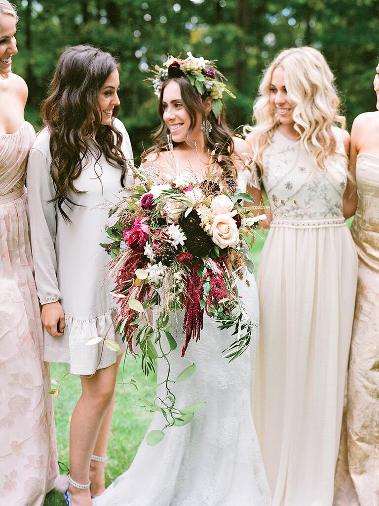 Cascading wedding bouquet idea with dahlias and roses