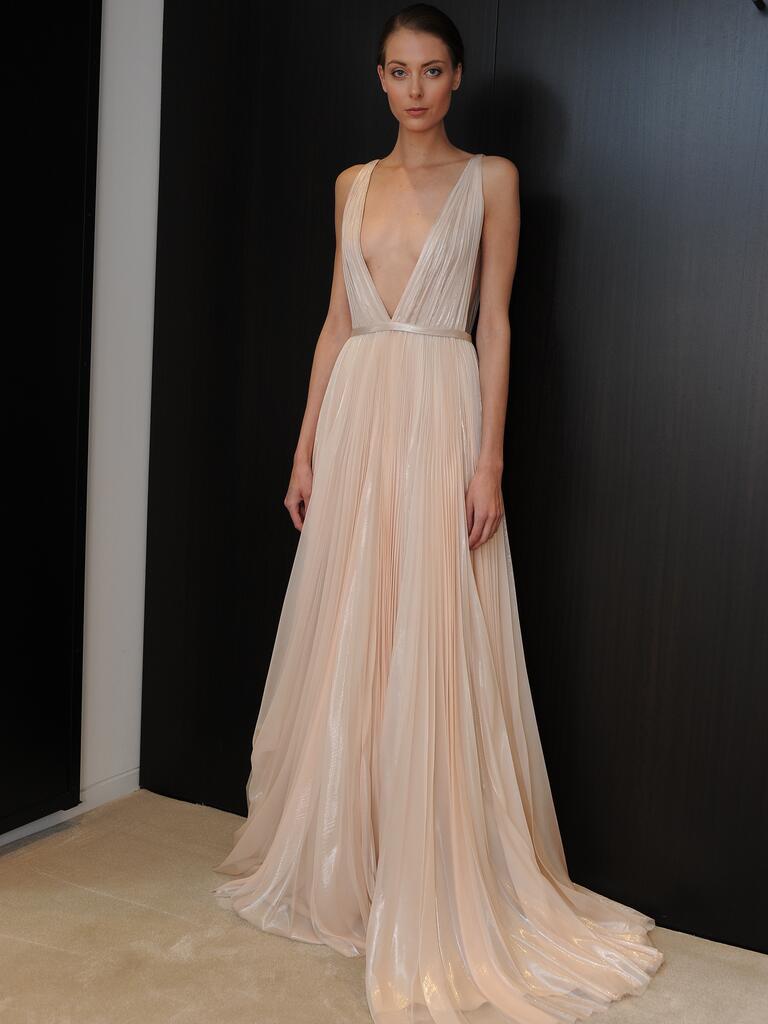 J mendel wedding dresses spring 2015 hit bridal fashion week for Plunge neck wedding dress