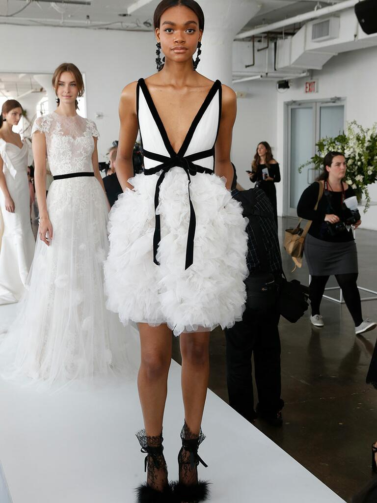 Marchesa Spring 2018 wedding cocktail dress with black fabric details, tulle textured skirt and black lace shoes