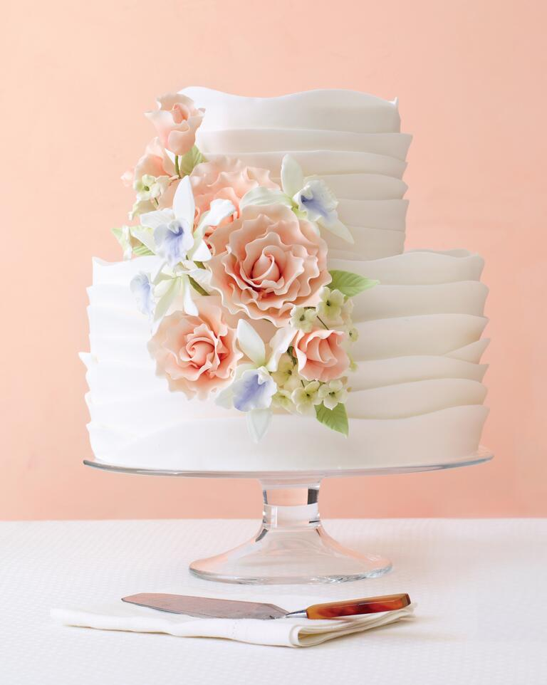 White ruffled wedding cake with sugar flowers