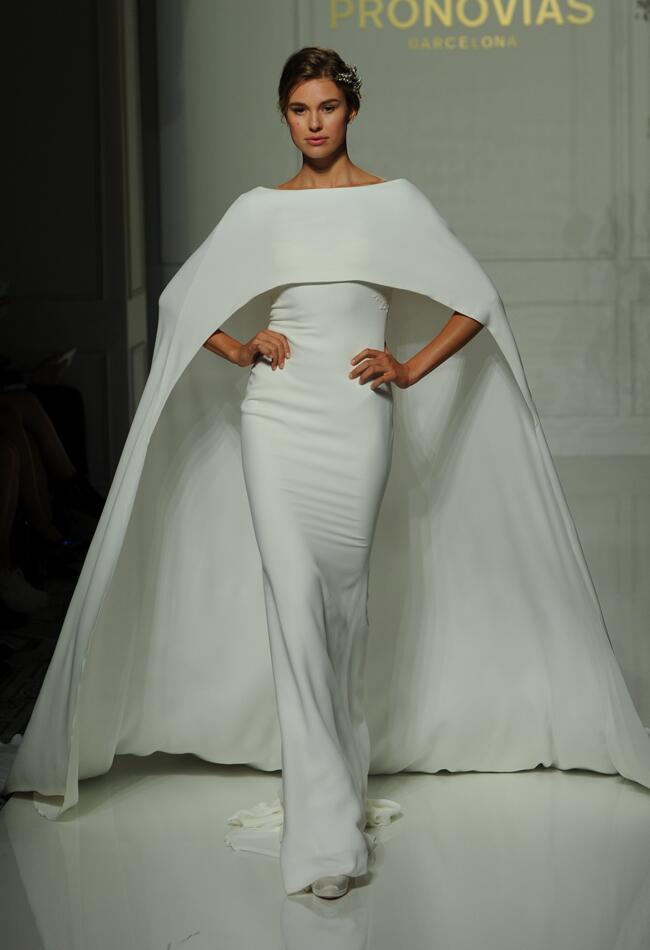 Pronovias white sheath style wedding dress with full cape fall 2016