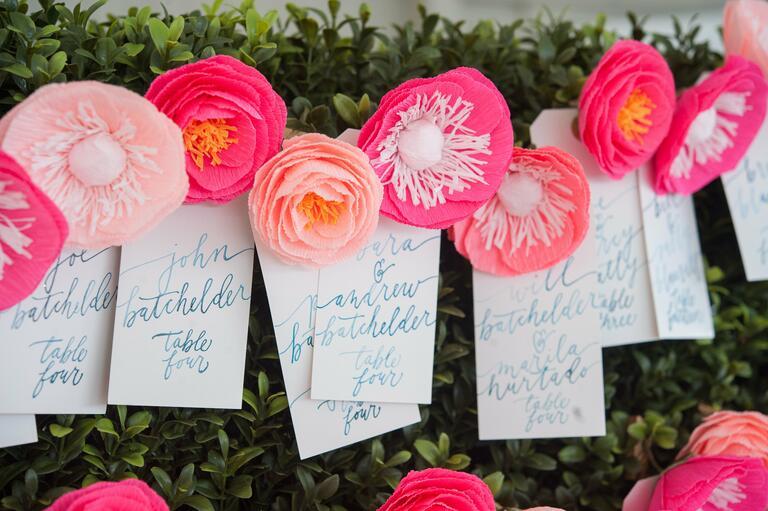 Pink paper flower escort card display