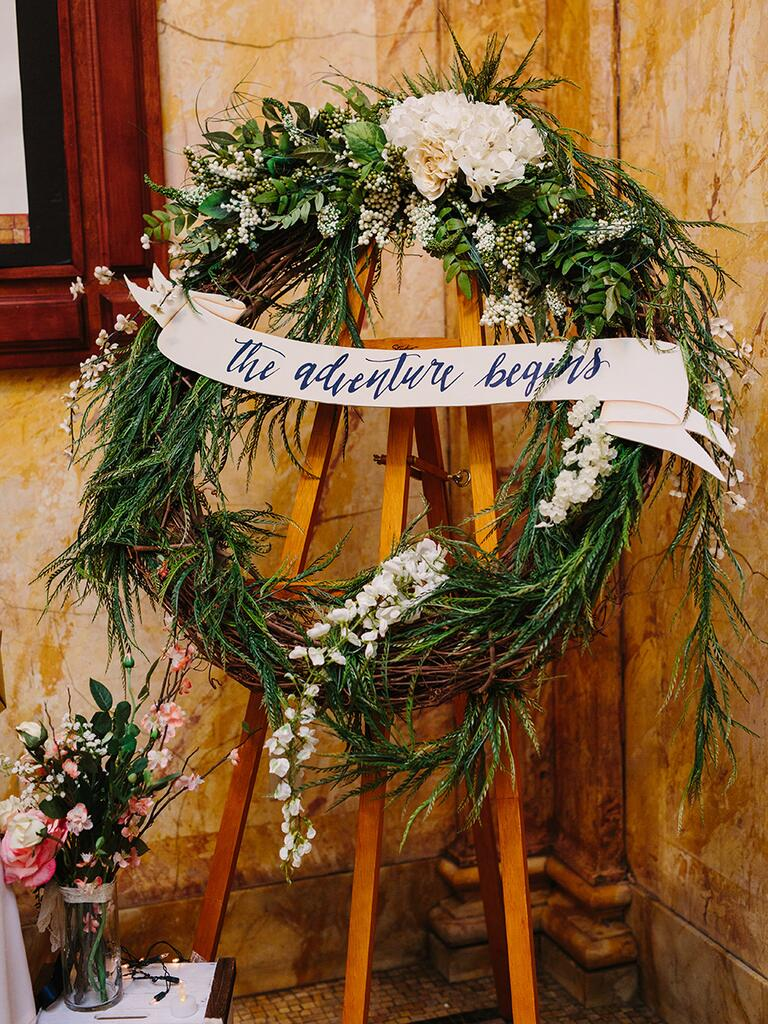 Flower and greenery wreath for a rustic wedding entrance