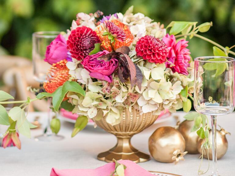 Bright pink and gold wedding centerpiece