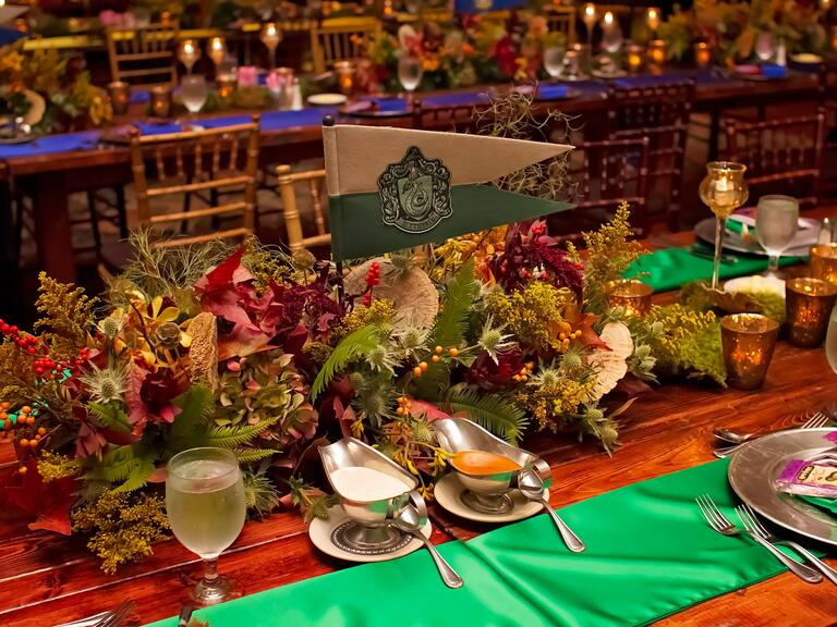 Table details with goblets, table runners and Harry Potter-themed flags