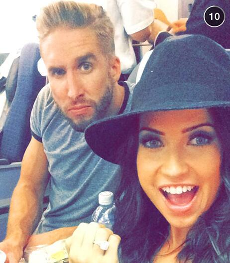 Kaitlyn shows off her ring while on a plane with Shawn