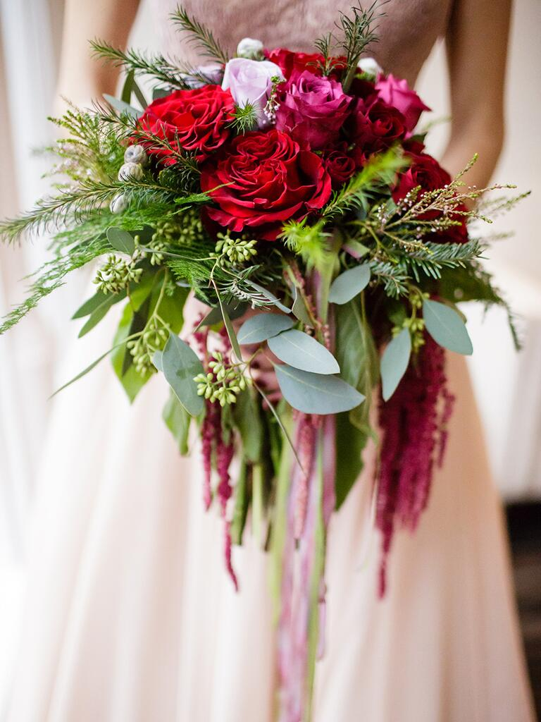 Cascading wedding bouquet idea with peonies and roses