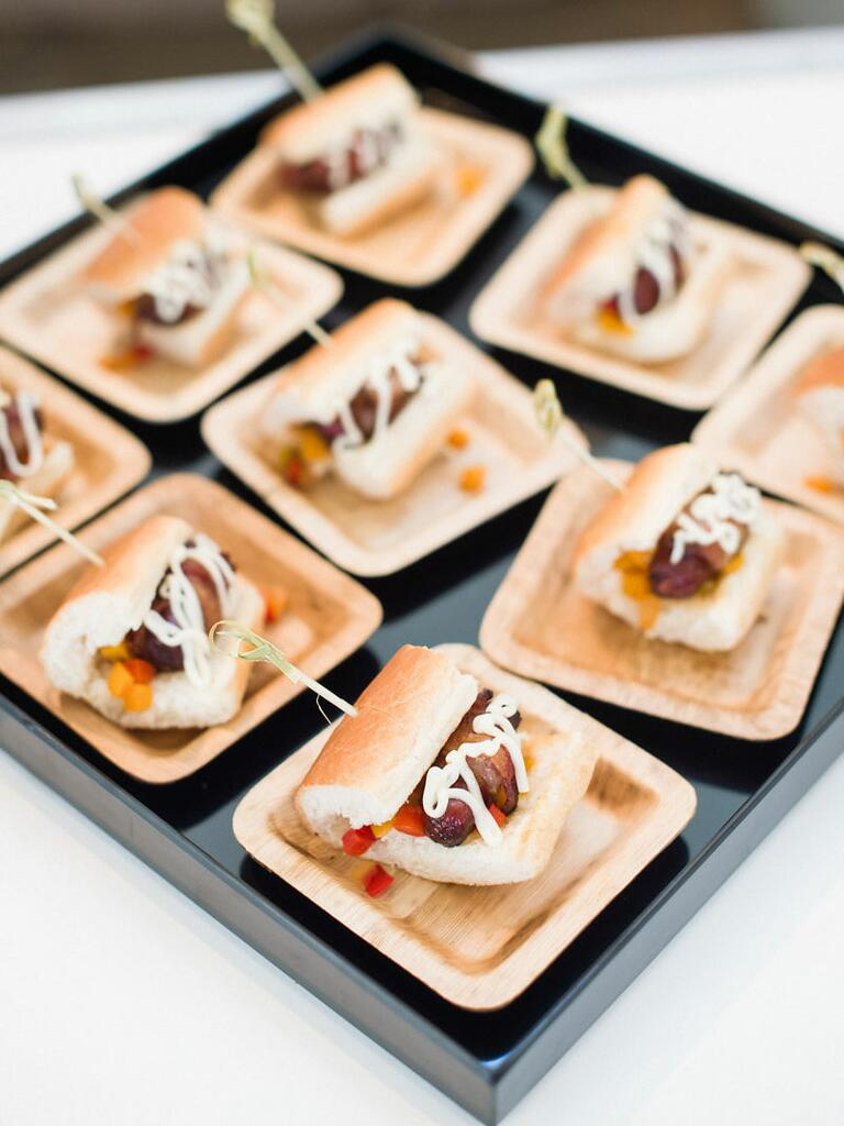 Mini bacon wrapped hot dog passed appetizers
