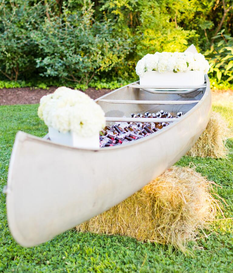 Canoe drinks cooler at barn wedding