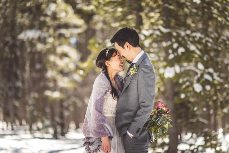 Couple surrounded by snowy woods