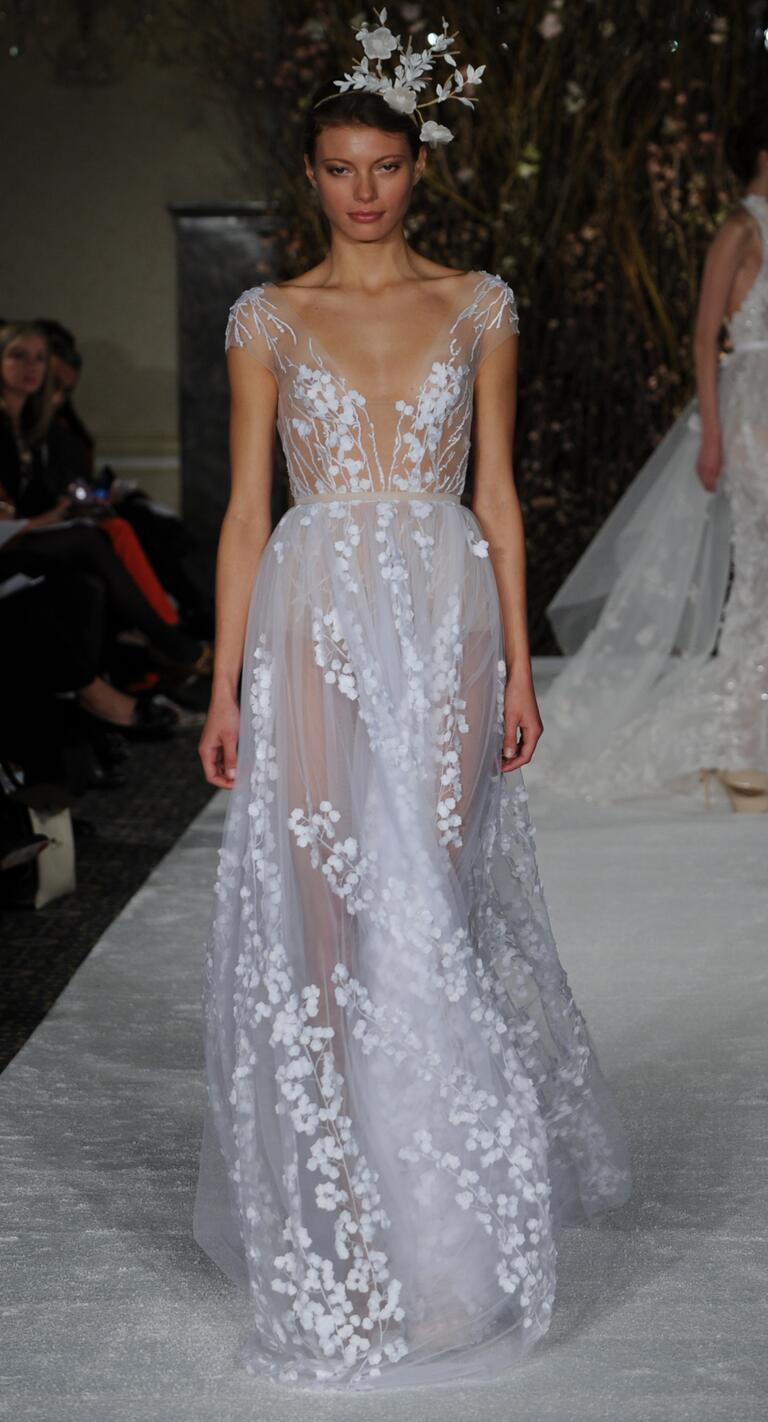 mira zwillinger wedding dresses bridal fashion week spring plunge wedding dress Mira Zwillinger Spring sheer A line wedding dress with plunging neckline and floral appliqu