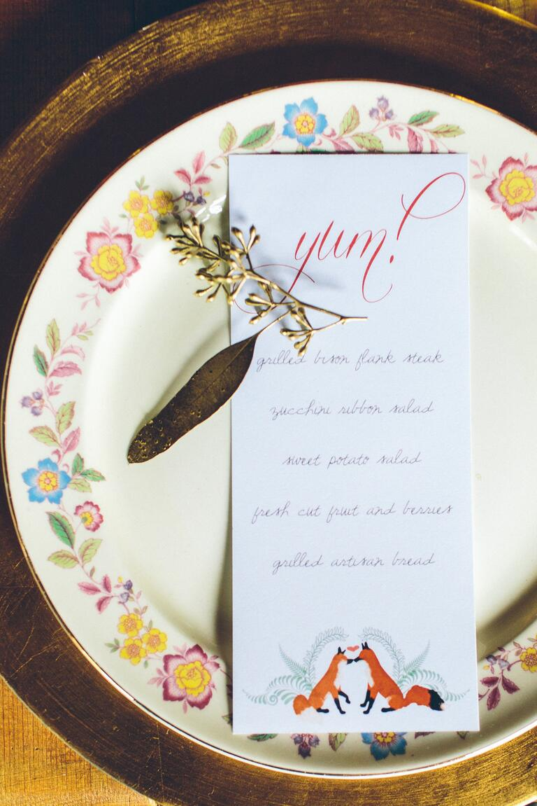 Wedding place setting with gold painted leaf