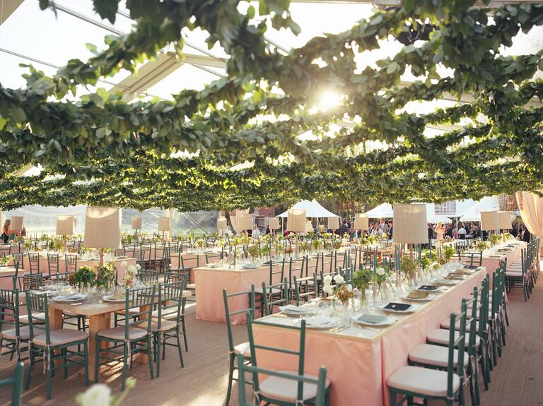 Wedding reception tent with a grid ceiling of lemon leaf garland