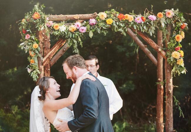Woodland wedding ceremony backdrop: Kate Harrison Photography / TheKnot.com