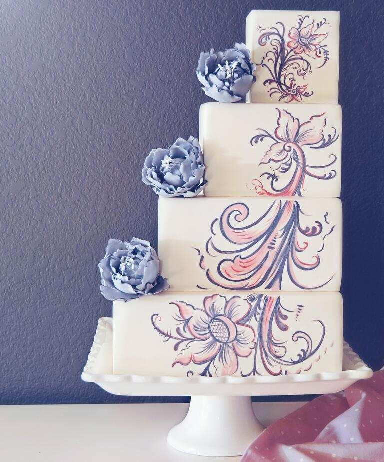 Staircase wedding cake with painted details