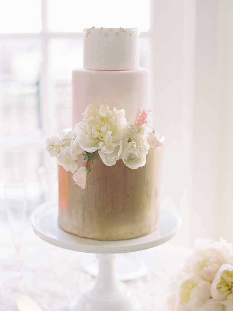 Romantic blush and gold three tier wedding cake with sugar flowers