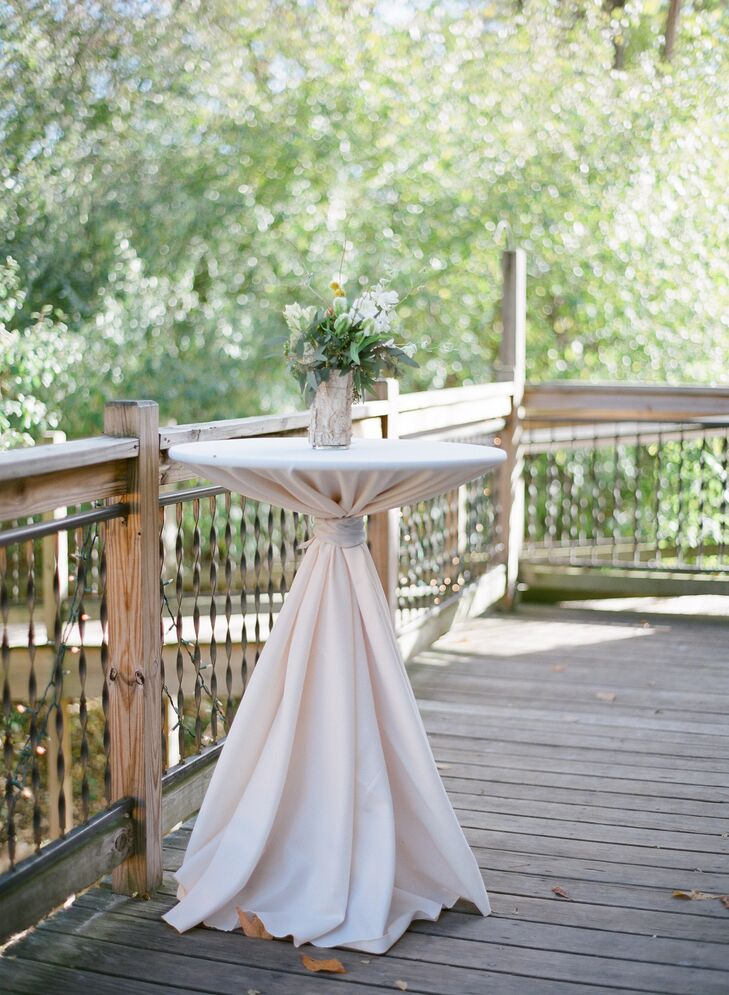 Linen Tablecloths with Green Floral Centerpiece