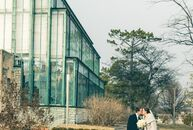 Brittny Koskela and Matt Koskela exchanged vows in a vaulted-ceiling greenhouse full of exotic palm trees, which lent an ethereal garden feel to their