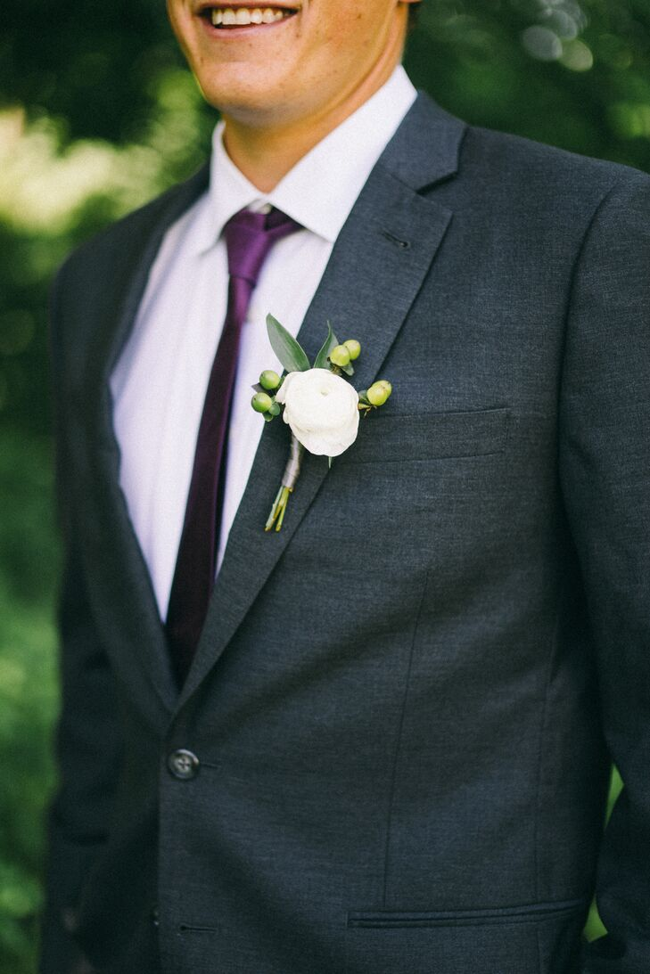 White Ranunculus and Hypericum Boutonniere