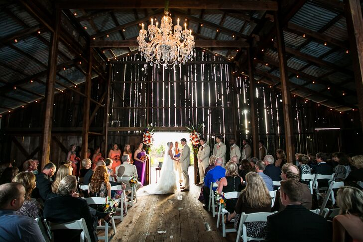 The couple was married inside a rustic barn at Soda Rock Winery in Healdsburg, California. An elegant chandelier hung above them as their ceremony took place.