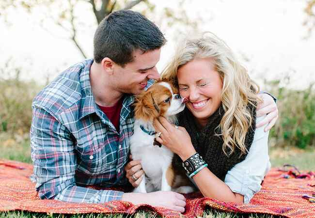 Engagement couple with cavalier king charles spaniel