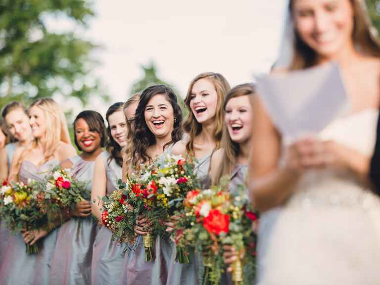 Bridesmaids laughing at ceremony vow exchange