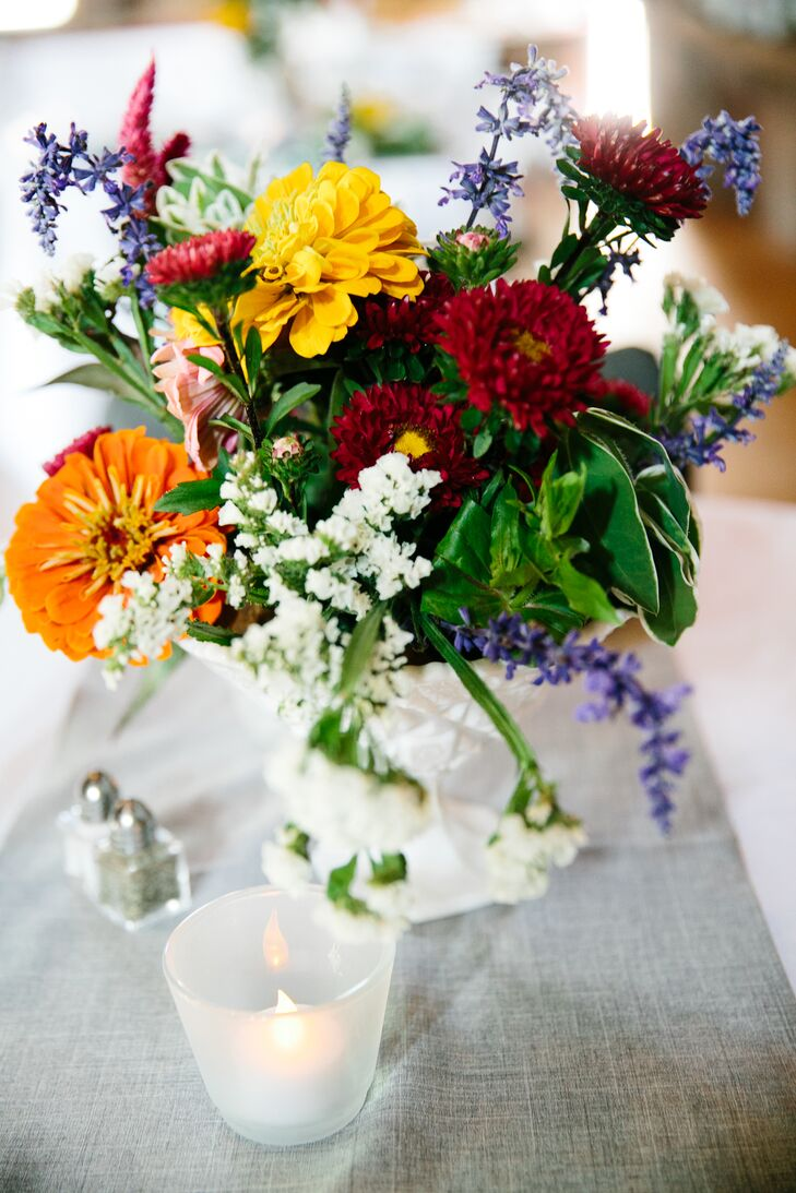 orange yellow burgundy wildflower centerpieces