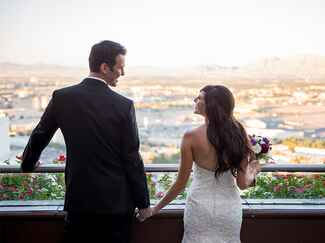 couple overlooking las vegas during their wedding reception at the mandalay bay