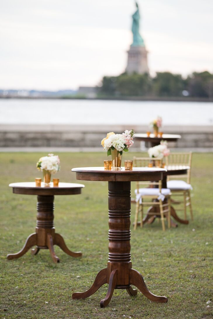"With a bit of luck, the weather was beautiful, allowing the couple to make the most of the setting. After saying ""I do"" in a traditional Jewish ceremony inside Ellis Island's Registry Room, the newlyweds and their guests headed outdoors for cocktail hour. While guests sipped on signature cocktails, like the French 75 (Lauren's favorite), they took in breathtaking views of the sun setting over the New York City skyline."