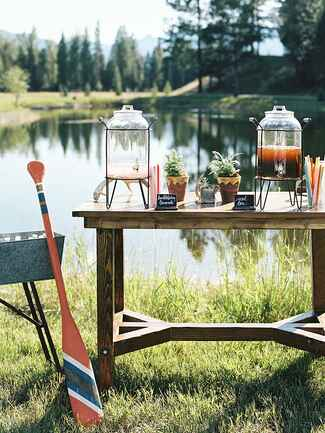 Outdoor lemonad and tea station for a rustic camp wedding