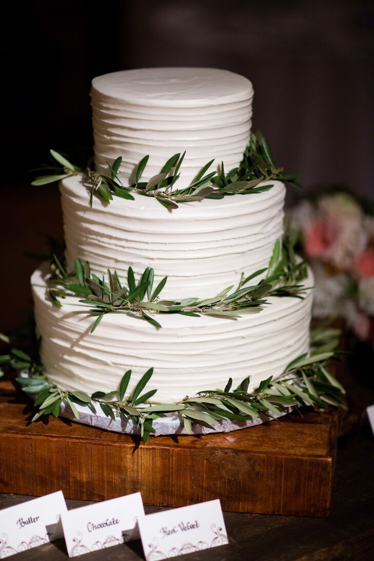 The couple had a simple, three tier cake with a simple ring of greenery around each layer.