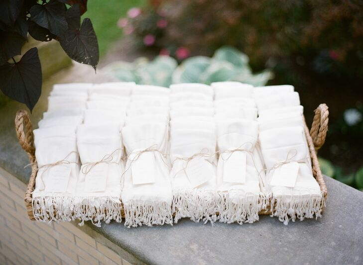 To keep guests cozy during the garden ceremony, Katie and Dave provided their guests with pashmina scarves in a soft shade of ivory. The shawls were wrapped with twine and finished with custom gift tags.