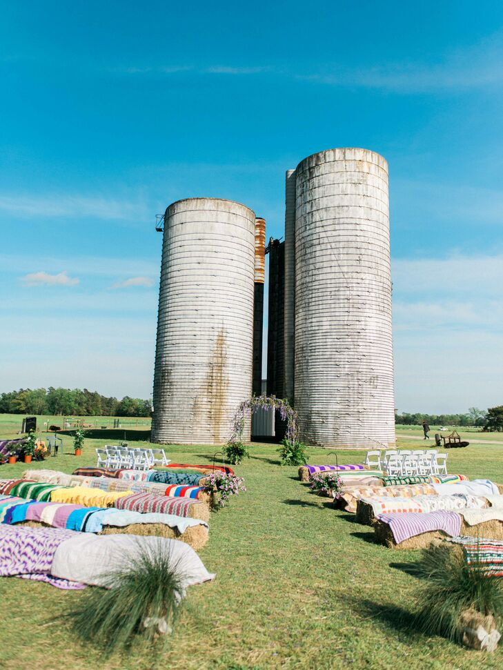 The ceremony took place nestled between two old grain silos not far from the reception  barn. Ashley and Brad set out hay bales and covered them with old quilts to create a cozy stop for the guests to enjoy the exchanging of vows.