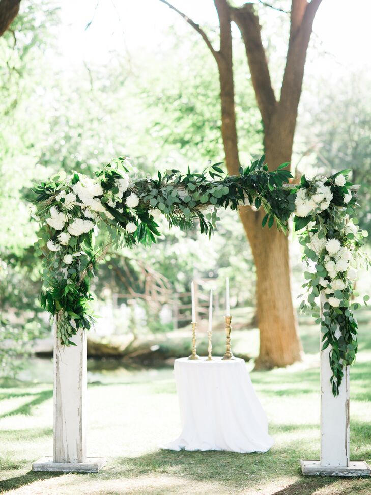 White Wood Ceremony Arch With Green Garland