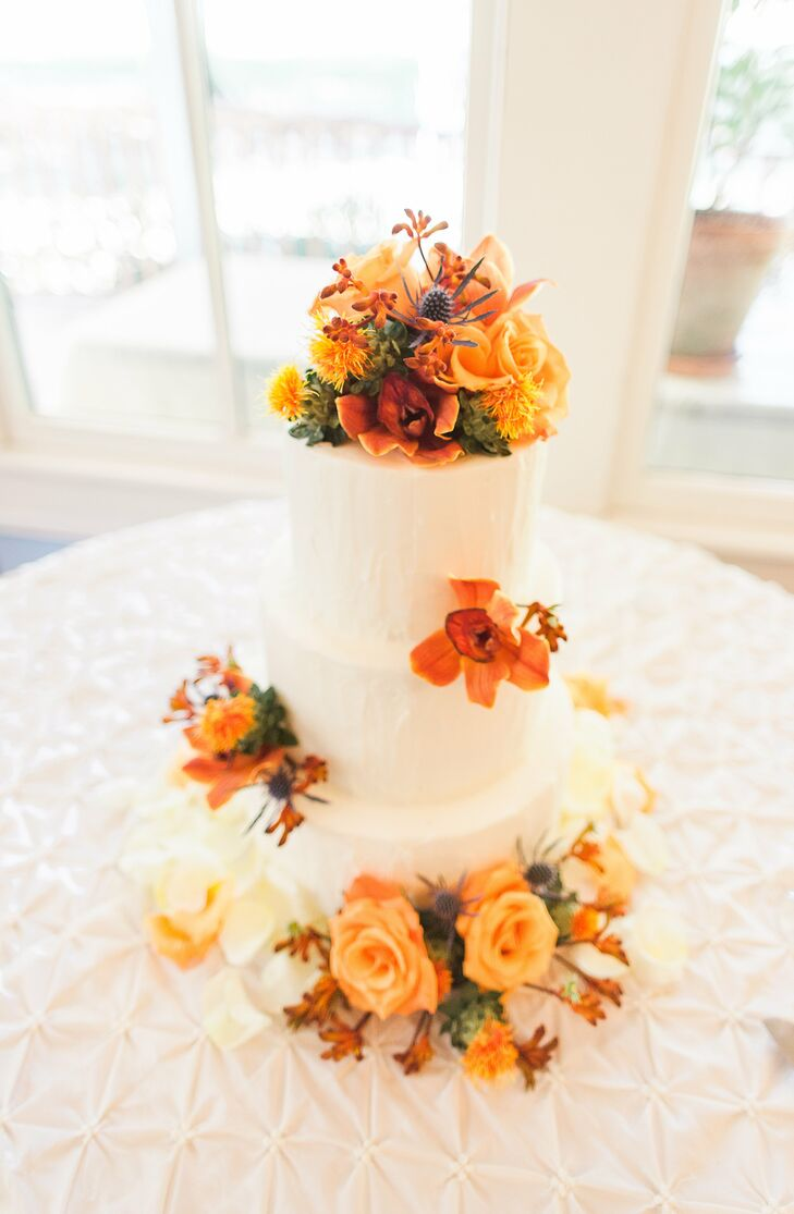 wedding cake with orange flowers three tier white wedding cake with orange flowers 26931
