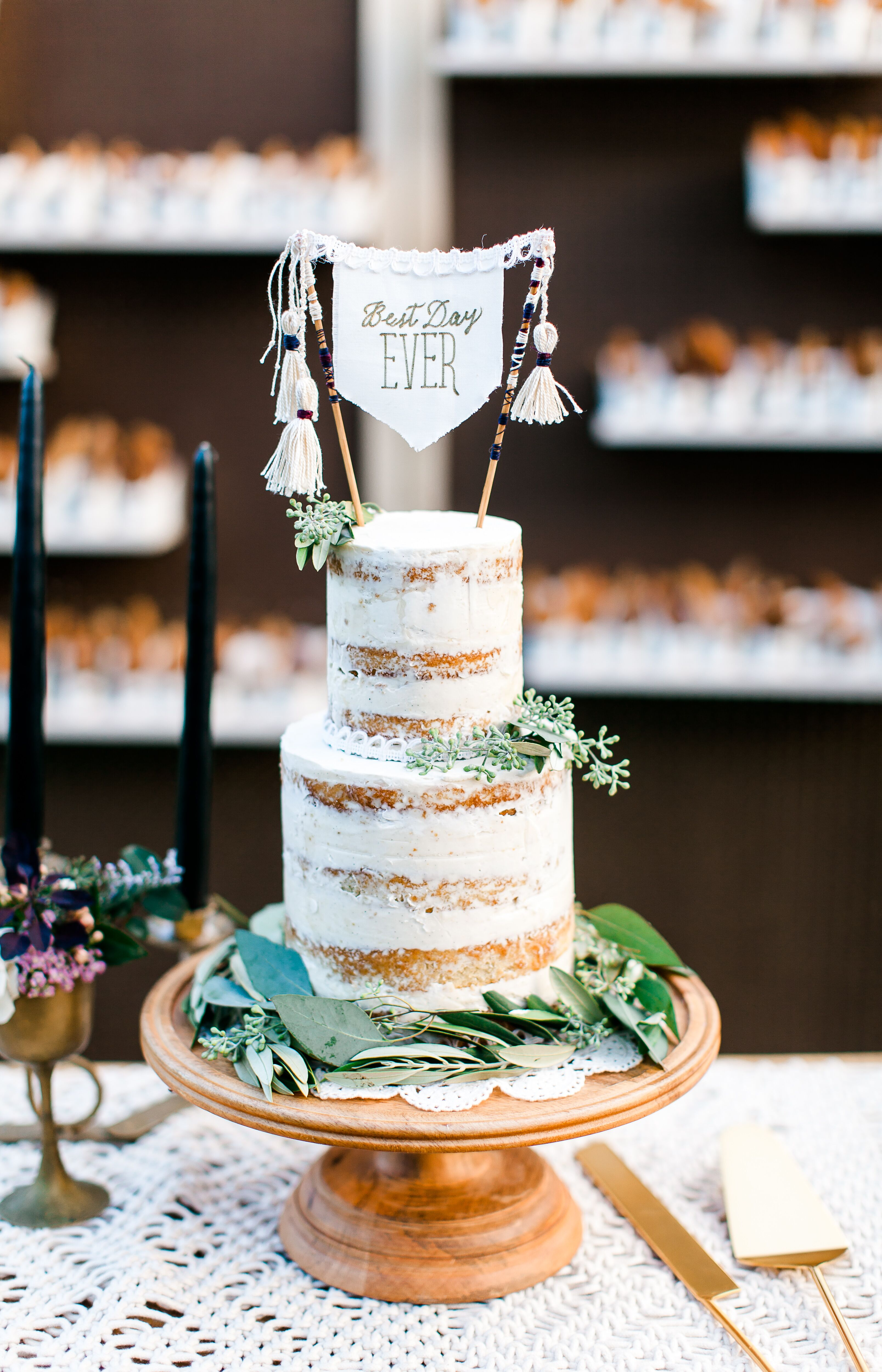 Naked Cake With Eucalyptus And A Tassel Topper