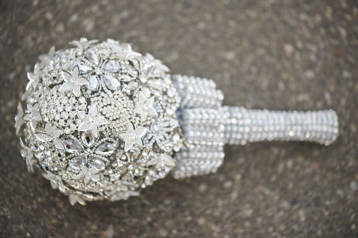 "The bride's mother created an antique brooch bouquet using collected jewels. ""She spent months gathering old rhinestones, pins and pearls to fill each and every spot,"" Brittany says. ""It was absolutely amazing and cannot be matched."""