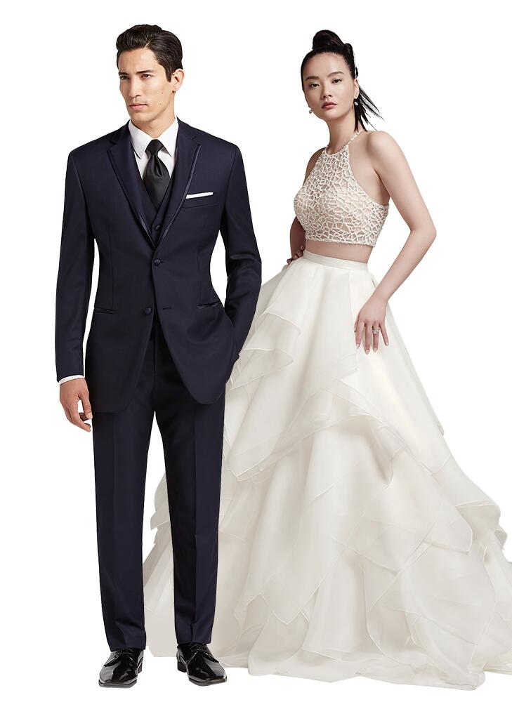 modern wedding dress and navy tuxedo