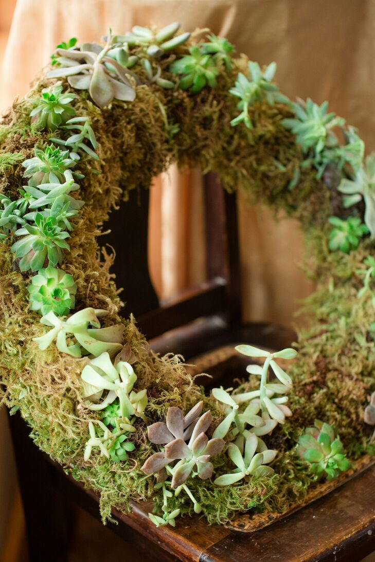 Green succulent and moss wreaths added a rustic touch to the ceremony and reception decor.