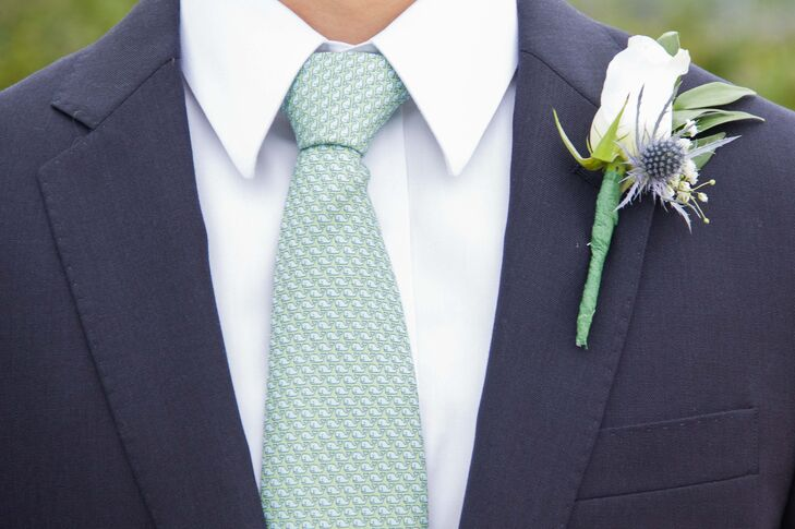 Brennan and his groomsmen added white rose and blue thistle boutonnieres to their navy suit jackets for a polished finish.