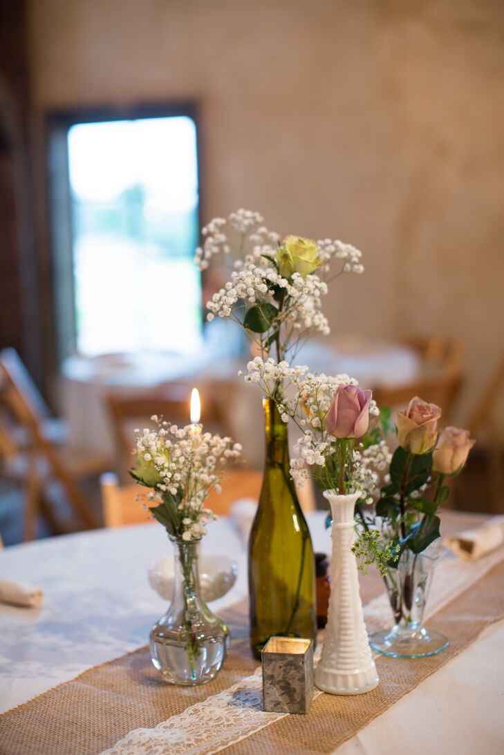 Simple rose and baby s breath centerpieces
