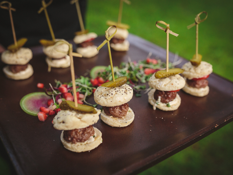 Mini sliders at wedding cocktail hour