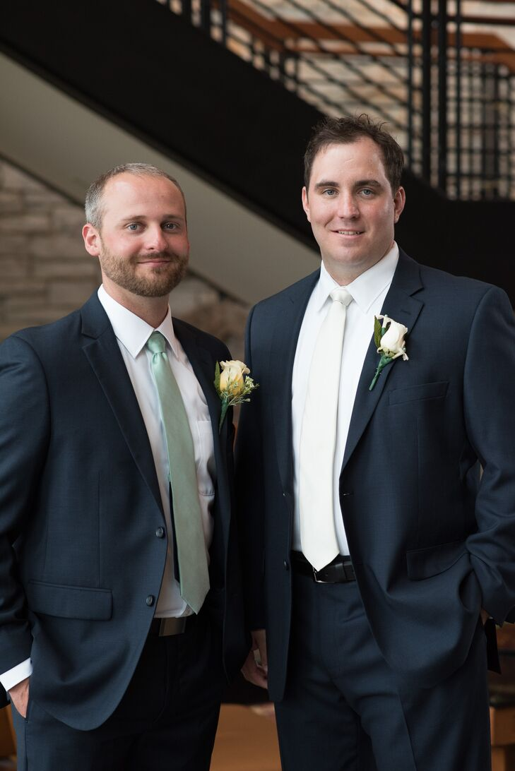 The groomsmen wore navy blue suits with mint green ties, while Jim wore an ivory tie. White rose boutonnieres completed the look.